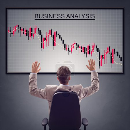 Photo for Businesman with trading stock market in economic crisis and line graph showing negative trend decline - Royalty Free Image