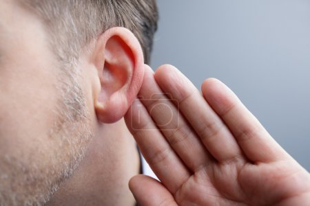 Photo for Man with hand on ear listening for quiet sound or paying attention - Royalty Free Image
