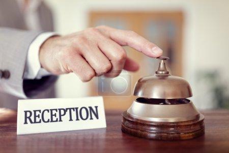 Businessman ringing hotel reception