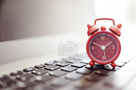 Alarm clock on laptop