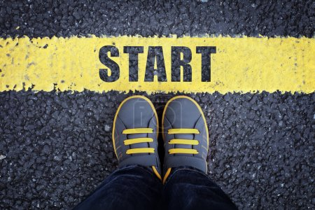 Photo for Start line,  child in sneakers standing next to a yellow starting line - Royalty Free Image