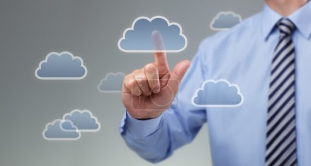 Photo for Businessmans hand pressing cloud icon on visual touch screen concept for cloud computing - Royalty Free Image