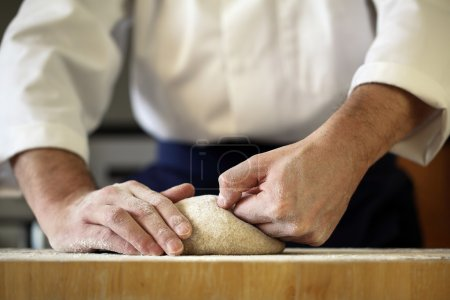 Photo for Making bread yeast dough, chef kneading in a bakery kitchen - Royalty Free Image