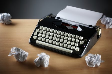 Photo for Frustration stress and writers block with old typewriter on desk and crumpled paper ball - Royalty Free Image