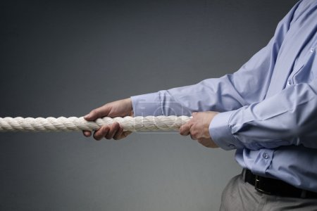 Business competition tug of war