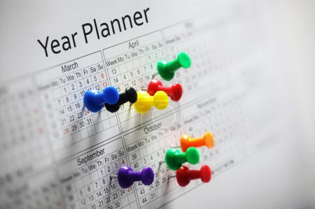 Year planner with thumbtacks