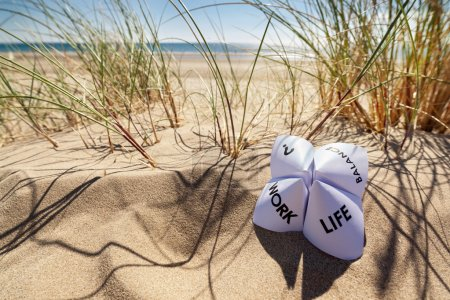 Photo for Origami fortune teller on vacation at the beach concept for work life balance choices - Royalty Free Image