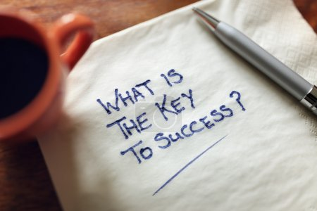 Photo for What is the key to success inscription on paper napkin, inspirational business concept - Royalty Free Image