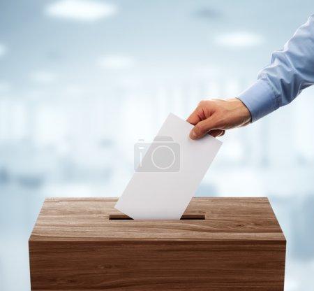 Ballot box with man casting vote