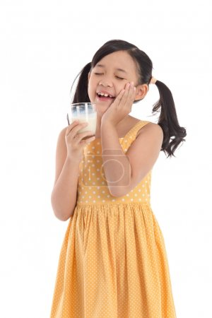 Cute asian child drinking milk