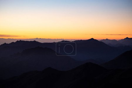 Photo for Mountain layers at sunrise on the top of Mousa Mountain in Egypt, South Sinai. Sinai mountains at sunset, Egypt - Royalty Free Image