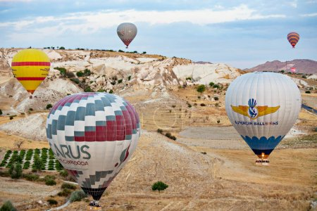 Photo for GOREME, TURKEY - December 2018: Colorful Hot air balloons in the air over Cappadocia (Kapadokya), Greme Turkey - Royalty Free Image
