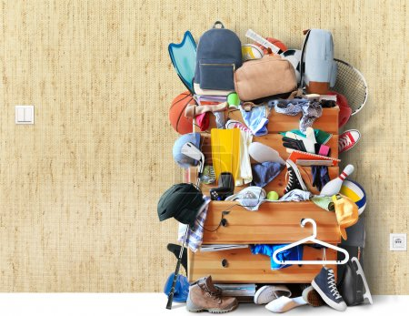 Photo for Mess, dresser with scattered clothes, shoes and other things - Royalty Free Image