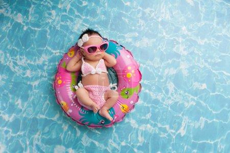 Newborn Baby Girl Wearing a Bikini and Sunglasses