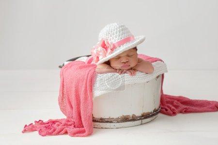 Newborn Baby Girl Wearing an Easter Hat