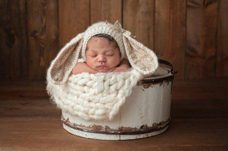Newborn Girl Wearing a Bunny Bonnet