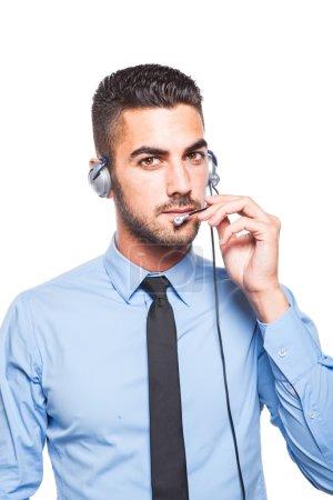 Male operator, handsome hispanic man in formal wear