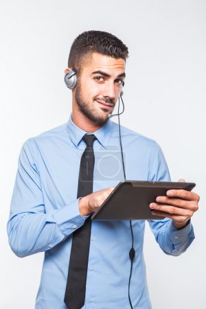 Male operator in formal wear with a tablet