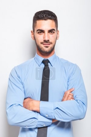 single elegant man in blue shirt with black tie