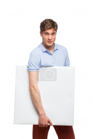 young blonde man showing empty panel isolated on white