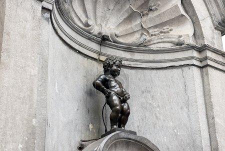 BRUSSELS, BELGIUM - JULY 6: Manneken Pis statue in Brussels. Sta