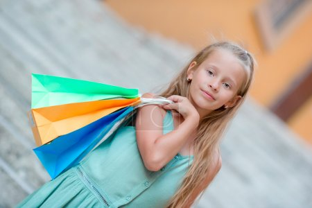 Photo for Portrait of adorable little kid with shopping bags - Royalty Free Image