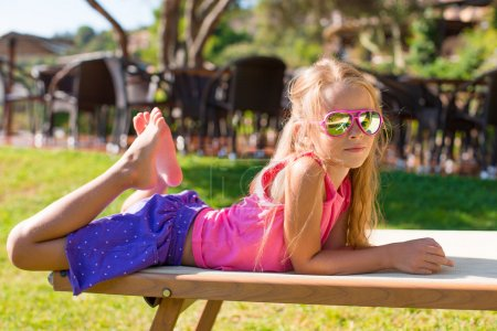 Photo for Little beautiful girl outdoors in exotic resort - Royalty Free Image