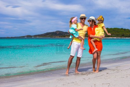 Happy family of four during beach vacation