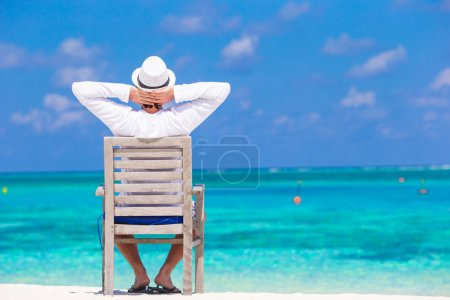 Young man enjoying summer vacation on tropical beach