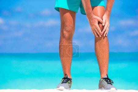 Photo for Female Athlete Suffering From Pain In Leg While Exercising - Royalty Free Image