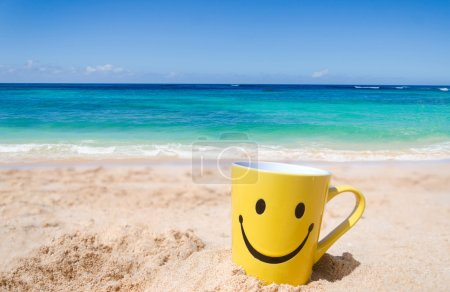 Photo for Happy face mug on the sandy beach - Royalty Free Image