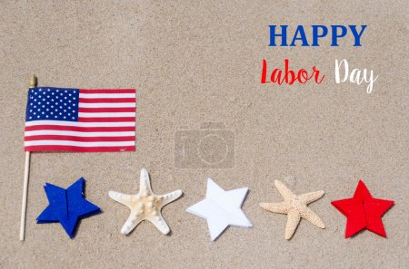 Labor Day with American flag starfishes on the sandy beach