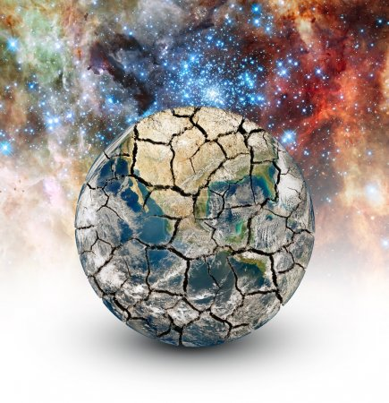 Cracked Earth on the background of the starry sky....