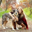 Постер, плакат: Woman and Dog in Woods in Autumn