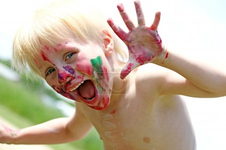 Happy Young Child with Messy Painted Face