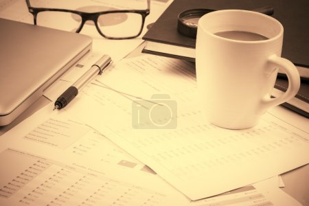 Business and financial report with coffee.Graph,bo...