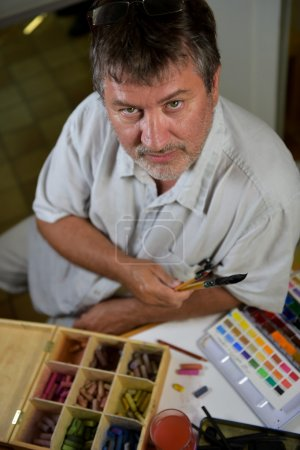 Portrait of a painter in his workshop