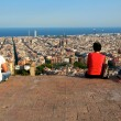 Постер, плакат: Young people are watching the skyline of Barcelona