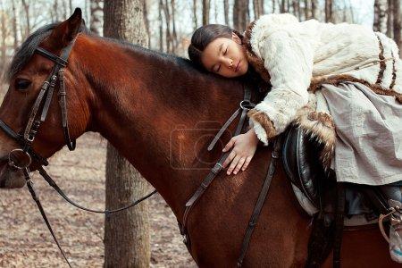 Mongolian girl with horse