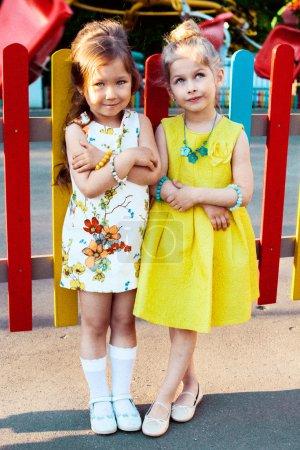 Little girls posing in park