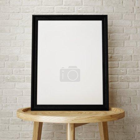 Mock up black frame on wooden low table, 3d rendering