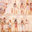 Egyptian hieroglyphs and pictures on the wall in A...