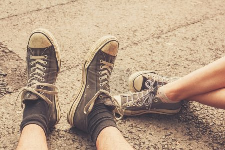 Young couples feet in the street