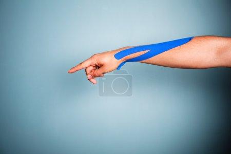 Arm with kinesio tape