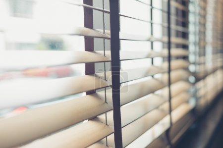 Venetian blinds by the window