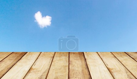 Wooden floor texture and blue sky background