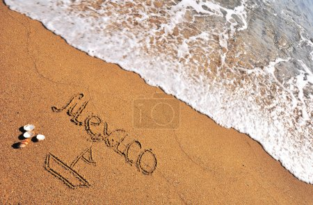 Mexico sign in the sand beach...