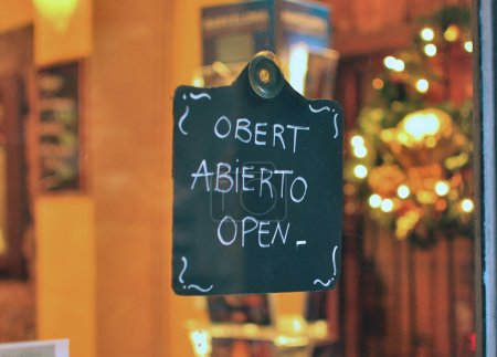 Open sign in catalan, spanish and english...