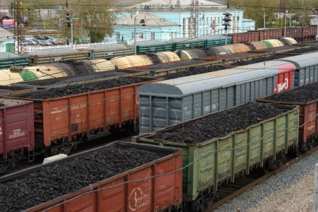 Freight cars, freight trains, tanks at the railway station