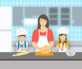 Mother with kids bake together at a kitchen